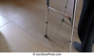 Disabled person with walking frame - Disabled or senior man...