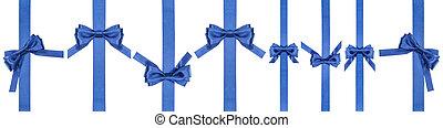 set of satin blue bows on narrow vertical ribbons