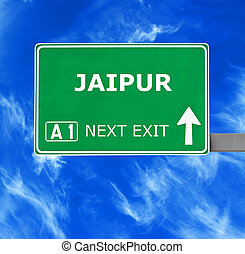 JAIPUR road sign against clear blue sky
