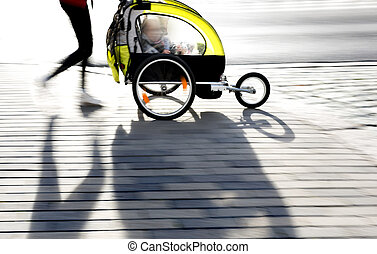 moyther with yellow pram - young mother with modern yellow...