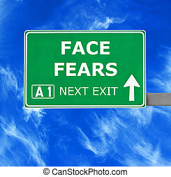 FACE FEARS road sign against clear blue sky