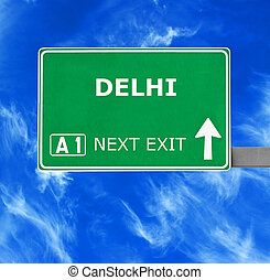 DELHI road sign against clear blue sky