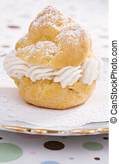 One Cream Puff - Cream puff filled with pastry cream, dusted...