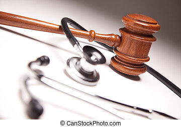 Gavel and Stethoscope on Gradated Background with Selective...