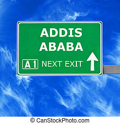 ADDIS ABABA road sign against clear blue sky - ADDIS...