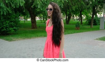 young beautiful long curly hair woman dancing outdoors -...