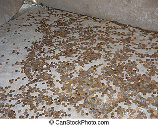 Coins on a concrete floor Throwing for luck and success of...
