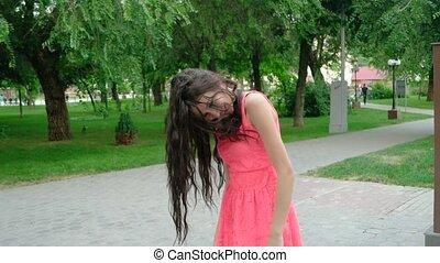 young beautiful long curly hair woman dancing outdoors -...