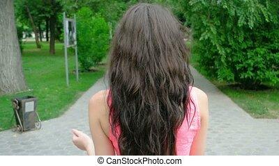 cute beautiful long curly hair woman dancing outdoors -...