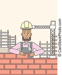 Bricklayer - A smiling black builder wearing a hard hat...
