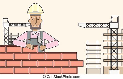 Bricklayer. - A smiling black builder wearing a hard hat...