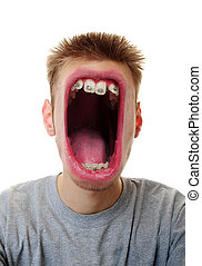 Big Mouth - A young adult white Caucasian male screaming his...