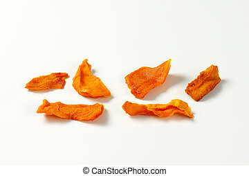 Dried mango slices on white background