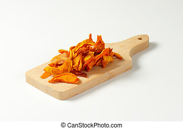 Dried mango slices - Heap of dried mango slices on wooden...