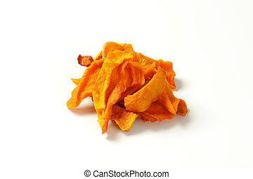 Dried mango slices - Heap of dried mango slices on white...