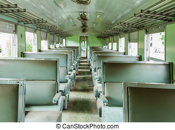 Interior of an empty antiqued train cabin in Thailand. -...