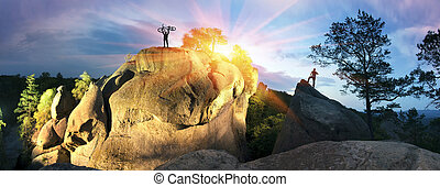 Cyclist on a rock - About Bolekhiv village in the...
