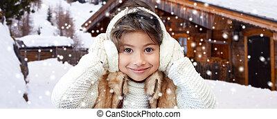 happy little girl wearing earmuffs - winter holidays,...