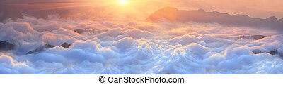 Dawn above the sea of fog - Bright saturated colors dawn...