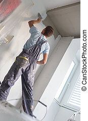 Plasterer renovating indoor walls and ceilings. - Thirty...