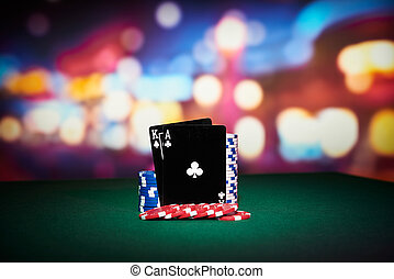 Poker chips with black cards on table in casino