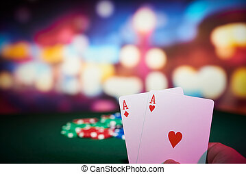 Poker chips with aces cards on table in casino