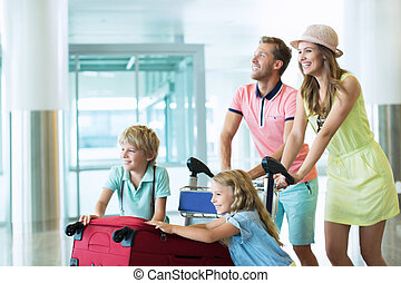 Passengers - Family with child in the airport