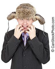 Emotional comical Russian man in fur hat
