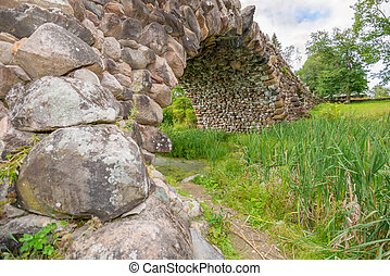 Hundred-meter boulder-arch bridge with two grotto - aviary,...