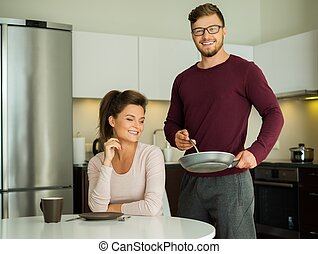 Young family on a kitchen at home