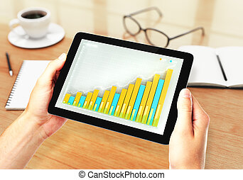 Man holding tablet with business chart