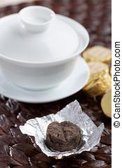 Pu-erh tea - Bricks of Pu-erh tea and gaiwan closeup