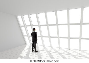 Businessman in the white loft interior