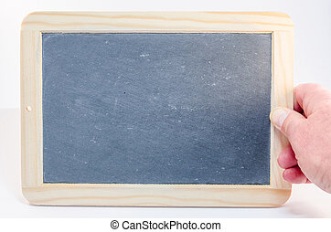 Hand holding a slate - Human hand is holding a slate without...