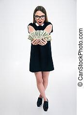 Cheerful female student holding dollar bills - Full length...