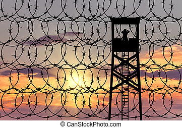 Silhouette of a lookout tower and borders
