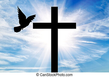Silhouette of a cross and dove - Concept of religion....