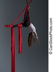 Girl performing aerial silk dance - Sporty woman doing...