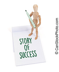 Wooden mannequin writing - Story of success