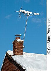 snow signal - snow covered television aerial on wintry...