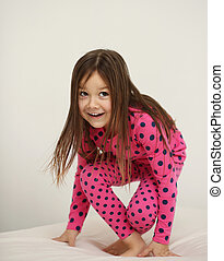 Cute girl jumping on the - Cute happy girl jumping on the...