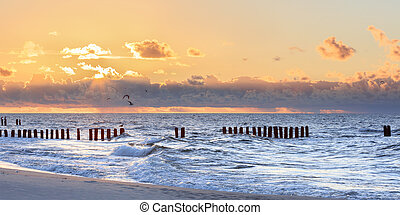 Dreamy blurred glowing sunset seascape - Wooden piles...