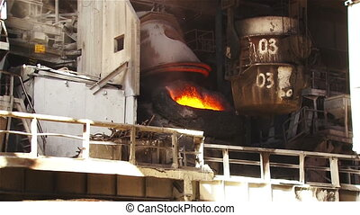 Bucket with hot metal factory - Hot steel pouring in steel...