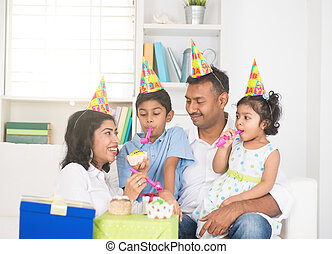 indian family birthday celebration with son and daughter
