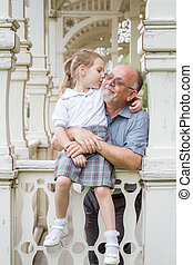 Little Girl with School Uniform and her Grandfather in Green...