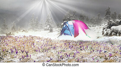Tent after the storm - On snowy mountain tops climbers and...