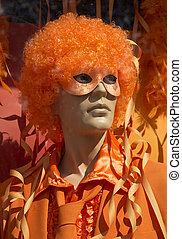 Mannequin man in orange halloween costume