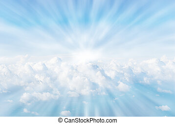 Sun rays in the clouds - white fluffy coulds from heaven sun...