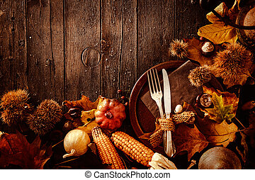 Thanksgiving dinner Autumn fruit with plate and cutlery...