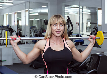 young girl in the gym for sports - young girl engaged in...